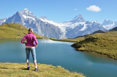 Traveler in the Alpine meadow  Jungfrau region, Switzerland photo