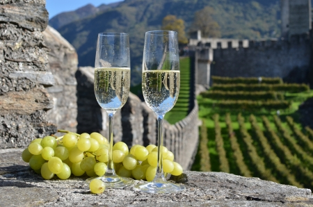 manor: Pair of champagne glasses and grapes  Bellinzona, Switzerland