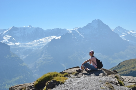 Traveler on the top of a rock  Switzerland  photo