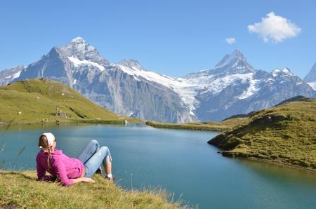 land animals: Traveler in the Alpine meadow. Jungfrau region, Switzerland