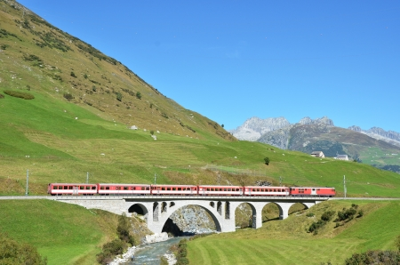 Train passing a bridge. Furka pass, Switzerland  photo