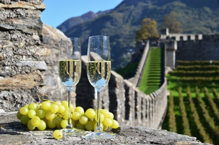 cluster house: Pair of champagne glasses and grapes. Bellinzona, Switzerland