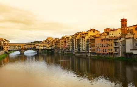 Ponte Vecchio bridge across Arno river in Florence, Italy  photo
