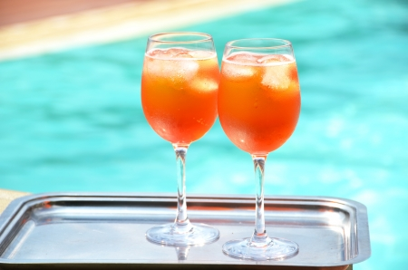 spritz: Pair of traditional Italian Spritz cocktails at the swimming pool