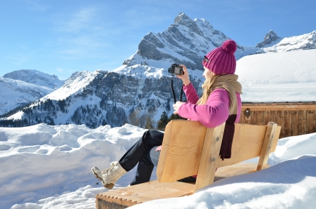 Girl with a camera in Swiss Alps photo