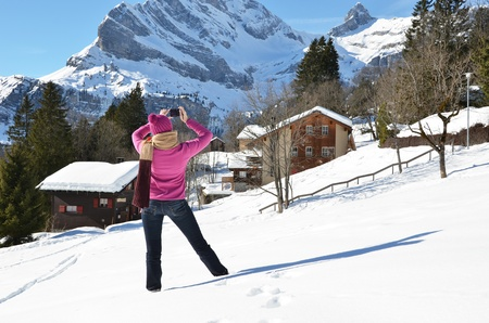 hobby hut: Girl taking a photo in the Swiss Alps