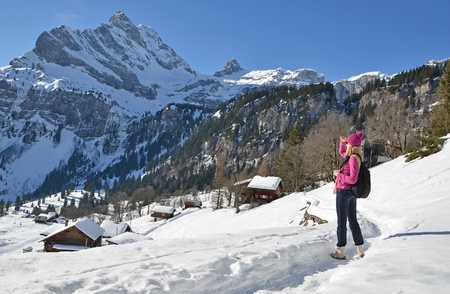 Traveler enjoying Alpine panorama  Braunwald, Switzerland
