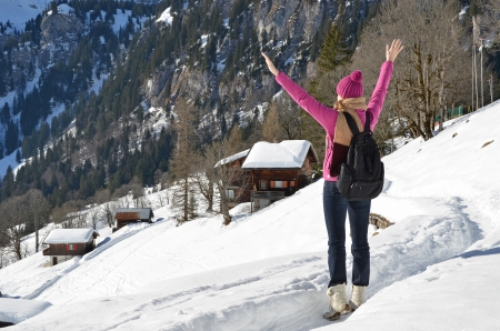 Traveler enjoying Alpine panorama  Braunwald, Switzerland photo