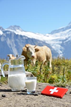 chocolate peak: Swiss chocolate and jug of milk on the Alpine meadow  Switzerland