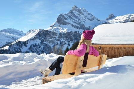 hobby hut: Traveler enjoying Alpine panorama. Switzerland Stock Photo
