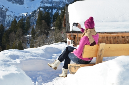 hobby hut: Girl with a camera in the Swiss Alps