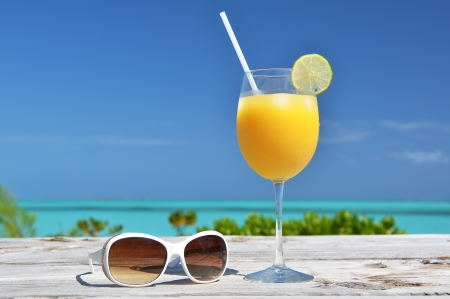 Orange juice and sunglasses  Exuma island, Bahamas Stock Photo