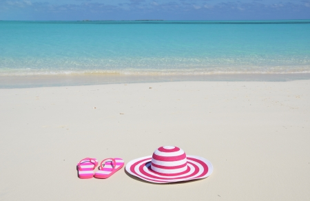 Flip-flops and hat on the beach of Exuma, Bahamas photo