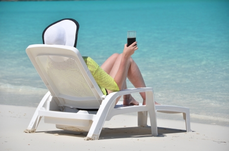 Girl with a glass of soda on the tropical beach  photo