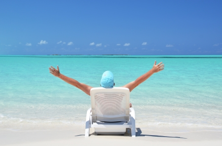 coolie hat: A young man sunbathing on the beach of Exuma, Bahamas Stock Photo