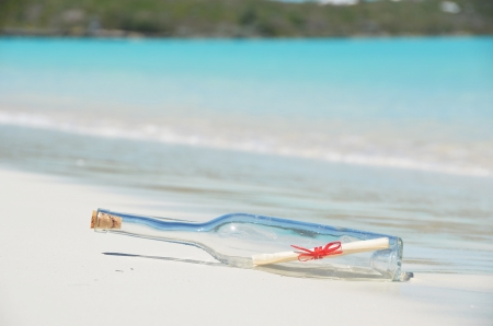 Bottle with a message on the beach photo