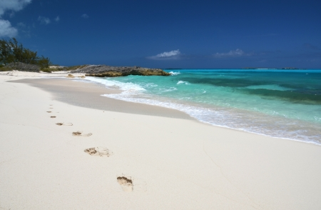 sandy feet: Footprints on the desrt beach of Little Exuma, Bahamas