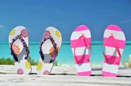 Women s shoes: Two pairs of flip-flops against Atlantic. Exuma, Bahamas