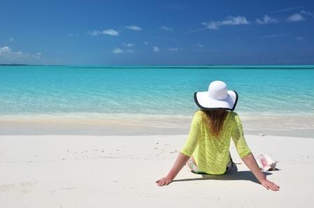 coolie hat: Girl on the beach of Exuma, Bahamas