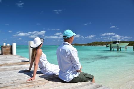 honey blonde: A couple on the wooden jetty. Exuma, Bahamas