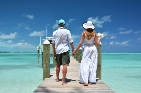 Couple on a wooden jetty. Exuma, Bahamas photo
