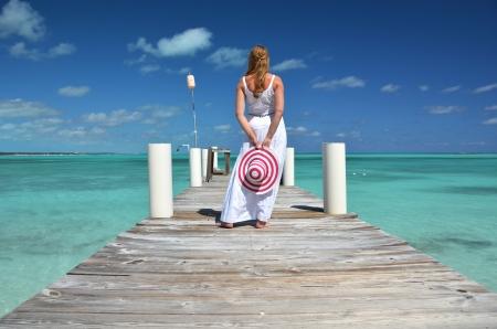 yacht people: Girl on the wooden jetty. Exuma, Bahamas
