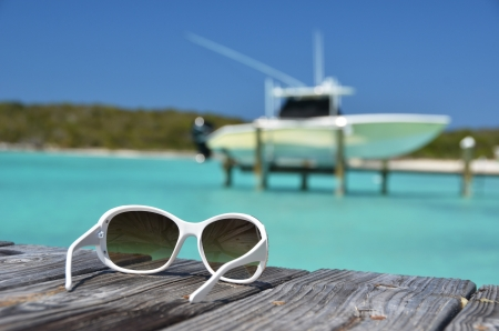Sunglasses on the wooden jetty photo