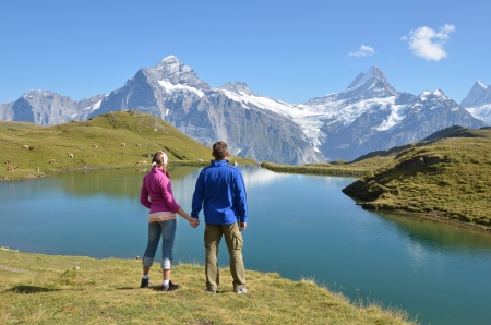 Travelers enjoying Alpine panorama. Jungfrau region, Switzerland photo