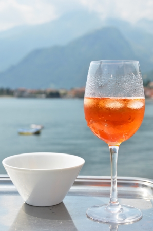 spritz: Traditional Italian Spritz cocktail against lake Como, Italy Stock Photo