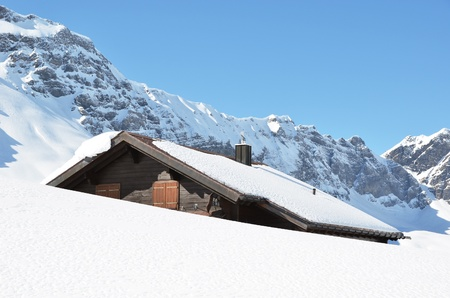 Farm house buried under snow, Melchsee-Frutt, Switzerland  photo