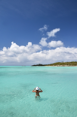 Girl in the turqouise water of Atlantic  Exuma, Bahamas photo
