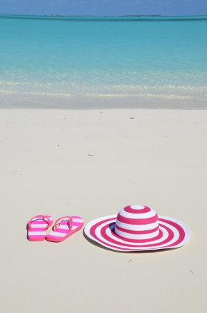flip flop: Flip-flops and hat on the beach Stock Photo