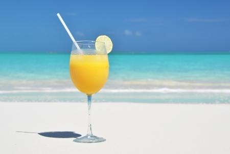 Orange juice on the beach  Exuma, Bahamas photo