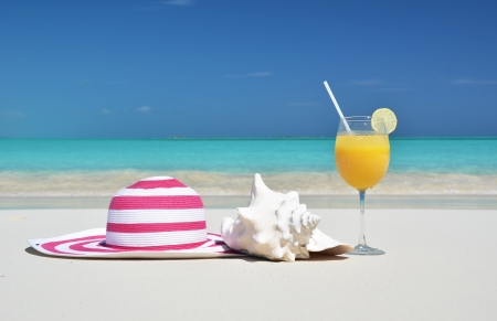 Hat and orange juice  Exuma, Bahamas photo