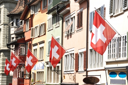 switzerland flag: Old street in Zurich decorated with flags for the Swiss National Day, 1st of August