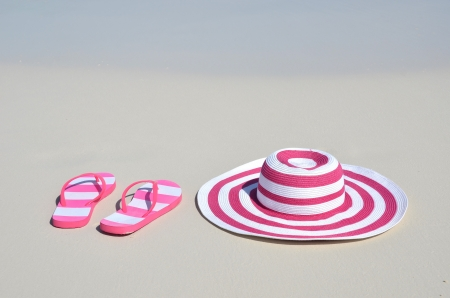 Flip-flops and hat on the beach  photo