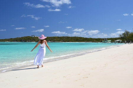 Girl in the hat on the beach of Exuma, Bahamas  photo