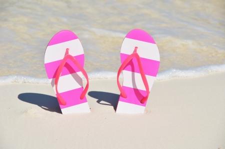 Flip-flops on the beach photo