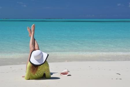 coolie hat: Girl on the beach of Exuma, Bahamas  Stock Photo