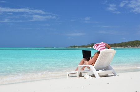 sexy office girl: Girl with a laptop on the tropical beach. Exuma, Bahamas