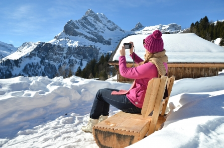 Girl taking a photo in the Swiss Alps photo