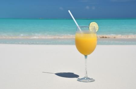 caribbean drink: Orange juice on the beach. Exuma, Bahamas