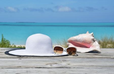 Hat and sunglasses on the wooden jetty. Exuma, Bahamas  photo