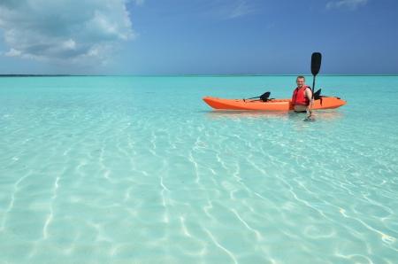 A man with kayak. Exuma, Bahamas photo