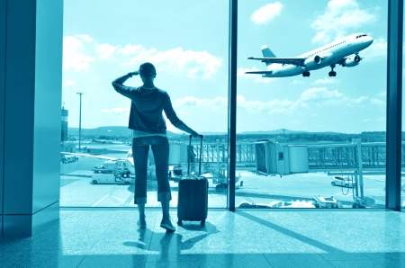 boarding: Girl at the airport window