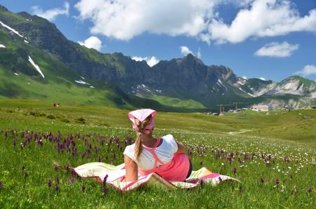 Girl in an Alpine meadow. Melchsee-Frutt, Switzerland photo