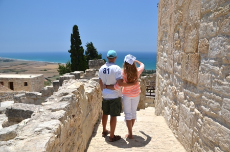among: A couple among ancient ruines of Kourion in Cyprus