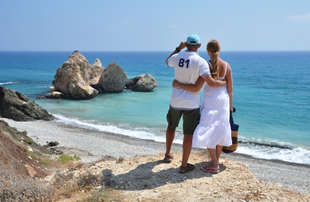 A couple looking to the coastline of Cyprus photo