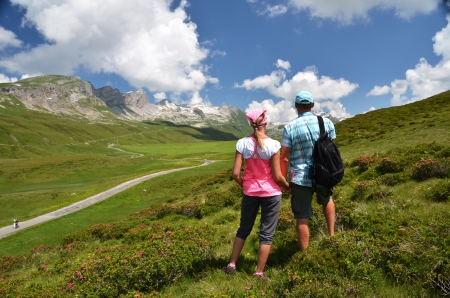 Travelers on the hill. Melchsee-Frutt, Switzerland photo