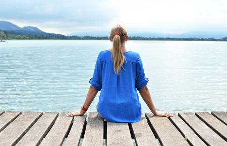 Girl on the wooden jetty  Switzerland Stock Photo